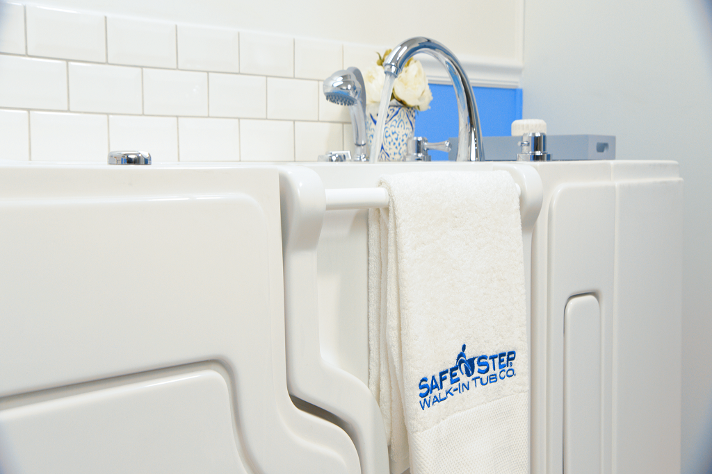 A branded Safe Step Walk-in Tub Co towel hanging from a Safe Step Tub hand grip
