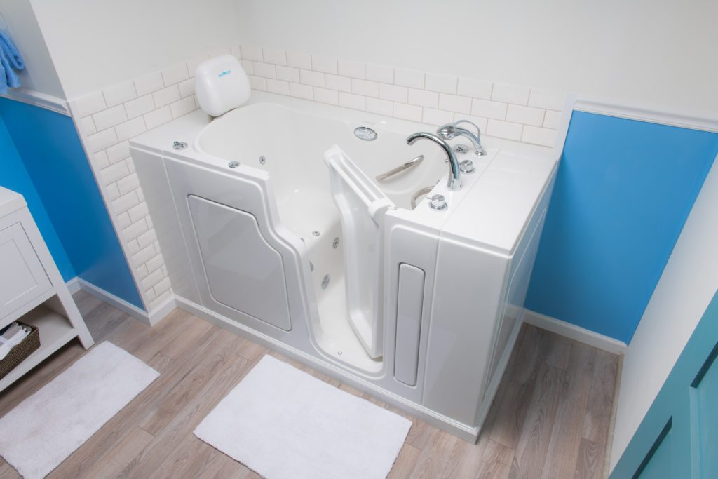 A Walk-In Tub demonstrated upon bathroom installation