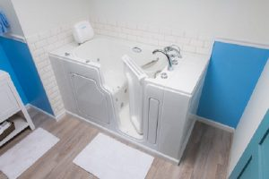 Full perspective of a walk-in tub with open door to see inside