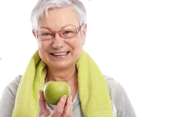 This elderly woman holding an apple demonstrates the need for proper nourishment while aging