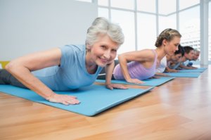 Senior woman staying healthy and limber through regular yoga exercises
